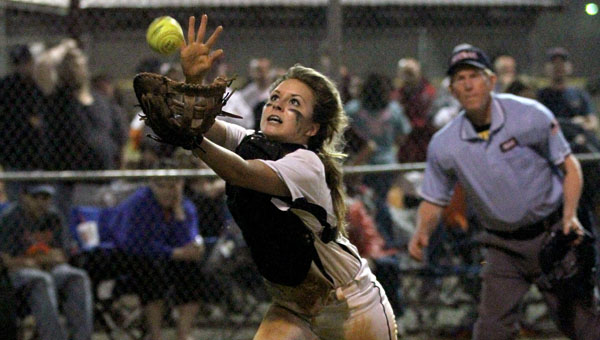 Jemison's Madison Moore reaches out to catch a pop up in a contest against Chilton County on the tournament's second day.