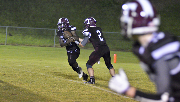 Hand off: Thorsby quarterback Conner McRae (No. 2) hands off to Terrell Davis on Friday. (Photo by Stephen Dawkins)