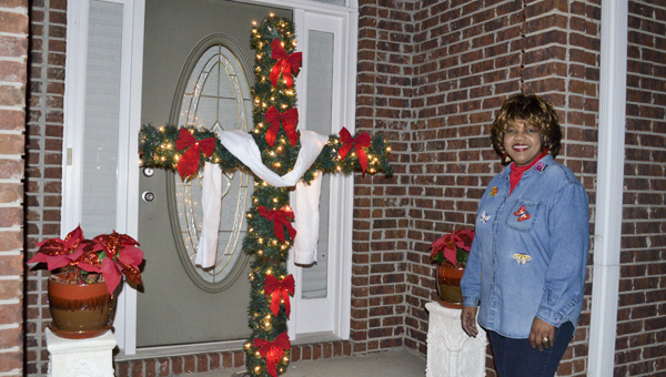 """Mae Carol Sails' """"CHRISTmas cross"""" is a sign of what the Christmas season means to her. (Photo by Anthony Richards)"""