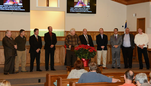"Lamar ""Heedy"" Hayes (at podium) was honored with a plaque and a State Senate resolution at Union Springs Baptist Church during the church's Dec. 11 service.(Contributed)"